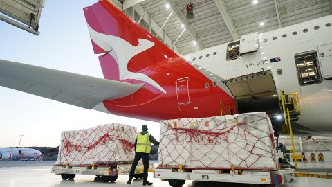 Nearly 100,000 N95 respirator masks are loaded onto a Qantas plane in Los Angeles on Jan. 6, 2020, bound for wildfire-impacted areas of Australia. Direct Relief maintains the largest private inventory of N95 masks in California, and is coordinating with Australian agencies and organization to distribute the masks where they're needed most. Qantas shipped the masks free-of-charge. (Lara Cooper/Direct Relief)
