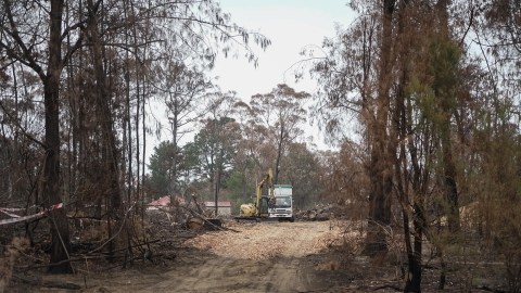 Crews work to clean-up debris in the fire-impacted community of Buxton, Australia, in January. The community lost several dozen homes during the recent blazes, and recovery work continues. (Lara Cooper/Direct Relief)
