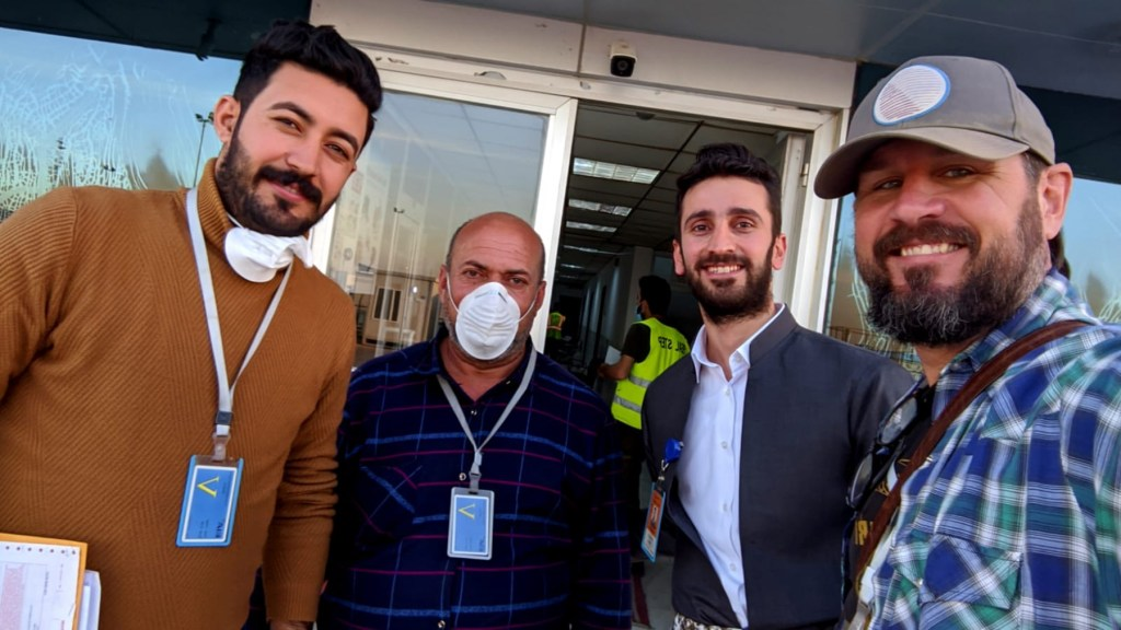 (L to R) Dr. Lazgeen Jamil, Pharmacist Mr. Ishmael, Dr. Hozan, who works for the Kurdistan Medical Control Agency, and Drew Kabbe at the airport in Erbil. This team received the medical supplies and handled customs. (Photo Courtesy of Culture Shock Productions)