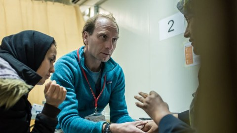 Dr. Stephen van de Vijver attends to patients in the Moria camp. (Photo by Tessa Kraan)