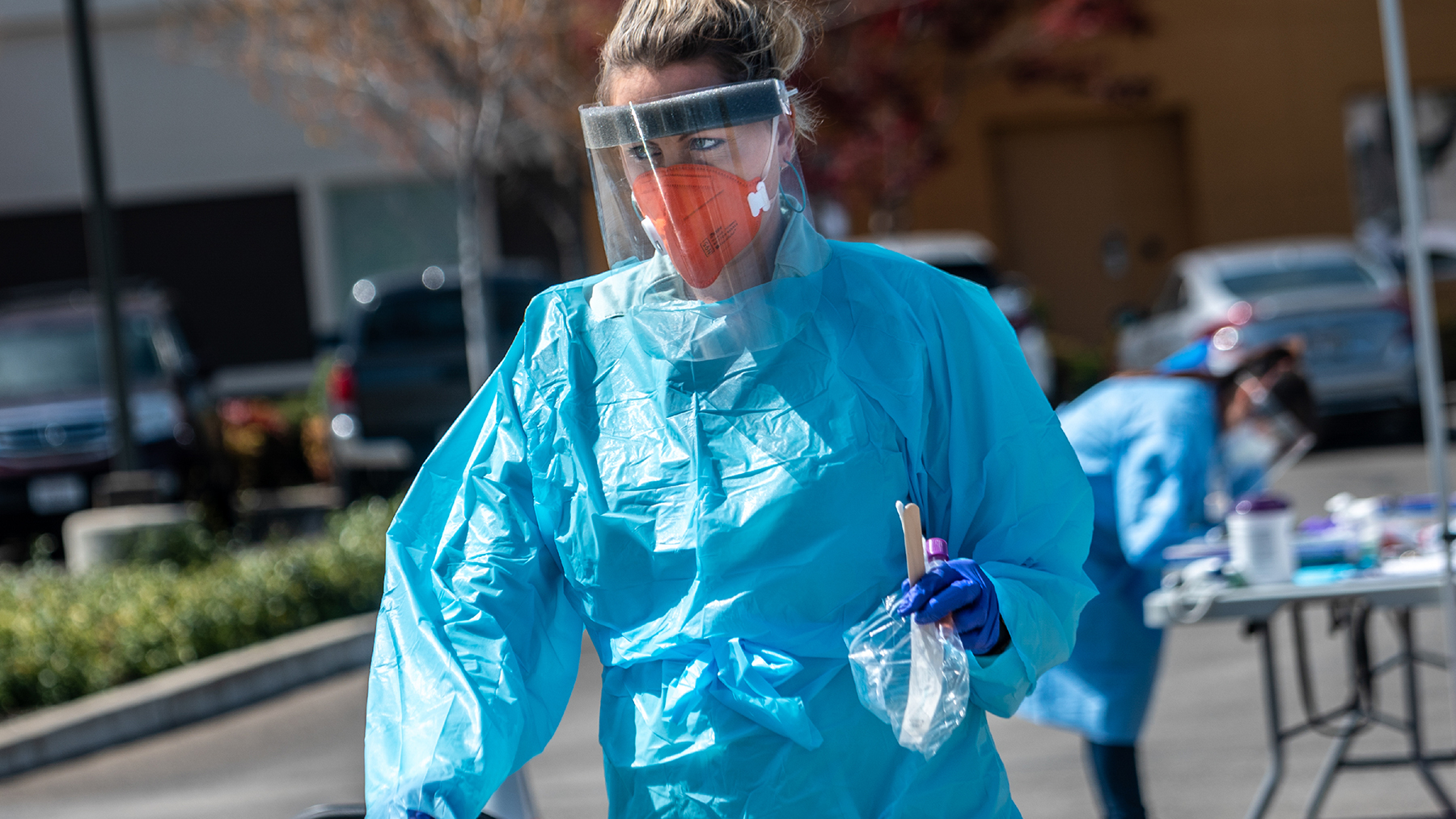 Staff with Ampla Health Care conduct Covid-19 testing at a drive-through site in Yuba City, California. The site was provided with protective gear from Direct Relief. (Photo by Renée C. Byer/ZUMA Wire)