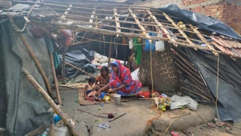 A family in a damaged structure. (Photo courtesy of Dr. Ravikant Singh)