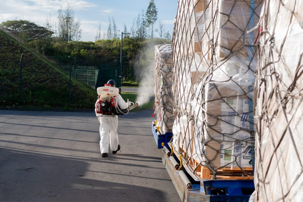 Staff of the Ecuadorian custom facilities disinfecting the donated shipment from Direct Relief, which arrived to the county on June 4, 2020 to mitigate the impact of the Covid-19 emergency in Ecuador. (Isadora Romero for Direct Relief)