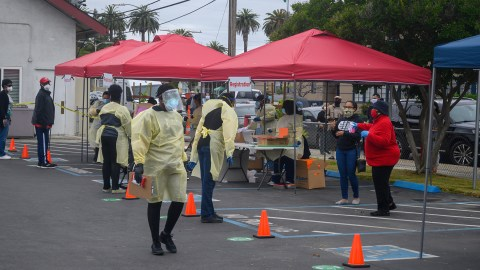 Health workers staff a San Jose, California temporary testing site. (Photo courtesy of Roots Community Clinic)