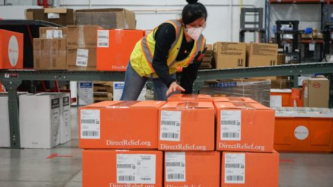 Shipments bound for health facilities across the United States are prepped for departure on Nov. 16, 2020, from Direct Relief's warehouse. The country is experiencing a third wave of Covid-19 cases, and the organization is ramping up shipment capacity to address increased requests. (Lara Cooper/Direct Relief)