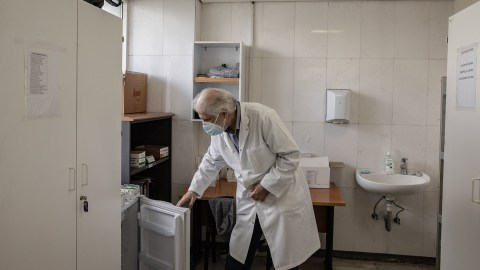 Dr. Akram Chtay, looking into a fridge containing Direct Relief-donated insulin in the pharmacy of the Rafik Hariri University Hospital, Beirut, Lebanon. Direct Relief has been able to provide critical donations to the facility since 2020's explosion. (Photo by Francesca Volpi for Direct Relief)