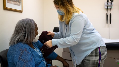 Free Clinic of Meridian staff member Desiree Wilson checks a patient's vital signs during a scheduled appointment on November 24, 2020. (Photo By Revere Photography for Direct Relief)