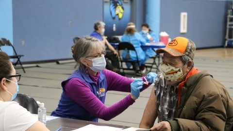 A resident of the Bristol Bay area receives the Covid-19 vaccine at one of BBAHC's local vaccine drives.