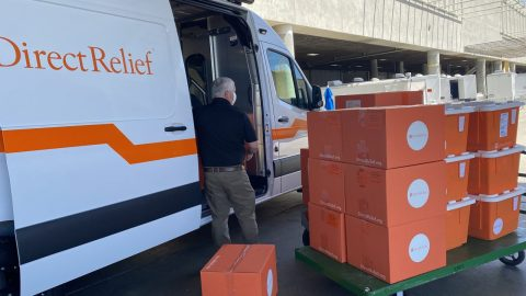 A Direct Relief staff member unloads medical aid at the San Diego Convention Center where thousands of migrant children will receive medical care and shelter. (Martin Calderon/Direct Relief)