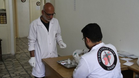 Medical staff prepare medication at the SAMS Oncology Center in Idlib, Syria. The facility is filling a gap for patients that would otherwise have to travel long distances for cancer care, or forgo treatment altogether. (Photo courtesy of Syrian American Medical Society)