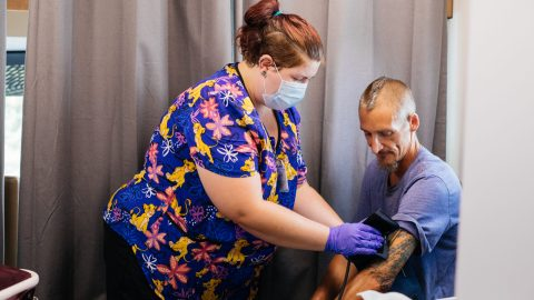 Brittany Carpenter, a medical assistant, works with patient James Tutwiler inside Cherokee Health's Mobile Clinic in Knoxville, Tenn. (Donnie Lloyd Hedden Jr. for Direct Relief)