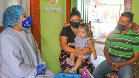 Medical staff from El Salvador-based NGO FUSAL conduct a home visit with a pediatric patient earlier this year. The group received medical support, including personal protective equipment, from Direct Relief over the past seven days. (FUSAL photo)