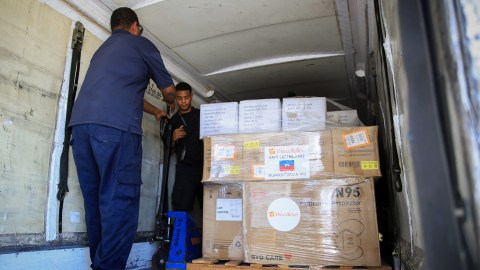 Personal protective equipment, or PPE, and other requested medical aidf is loaded onto a flight for delivery to Haiti from Puerto Rico. (Photo by Jose Jimenez Tirado for Direct Relief)