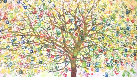 the wall at the center and `Tree of life` with handprints of children-patients at that time
