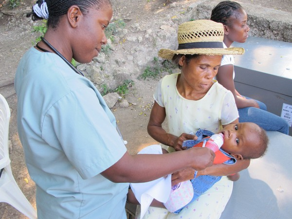 A nurse gives an infant Pedialyte at Polyclinique Camejo in Leogane, outside of Port-au-Prince.