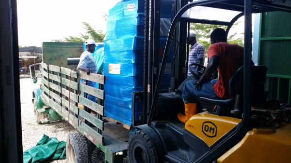 Workers load aid bound for St. Boniface Hospital in Fond-des-Blancs, Haiti.