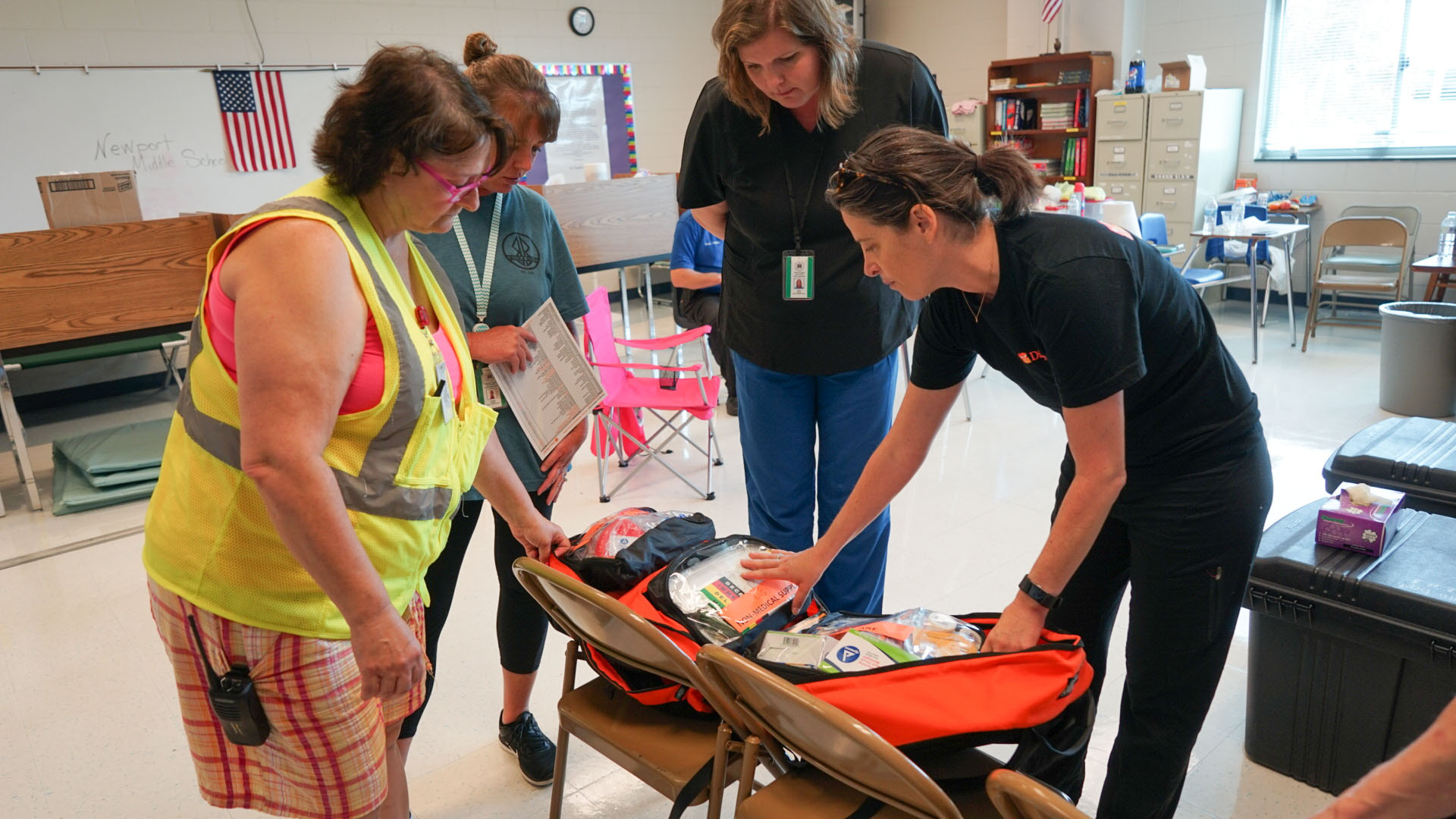 Direct Relief staff deliver emergency medical backpacks to a shelter operating out of a middle school in Newport, North Carolina. The shelter housed more than 400 people after Hurricane Florence made landfall, and health staff there used Direct Relief-provided medical supplies to treat an influx of patients after many were evacuated from their homes in the wake of rising floodwaters. (Lara Cooper/Direct Relief)