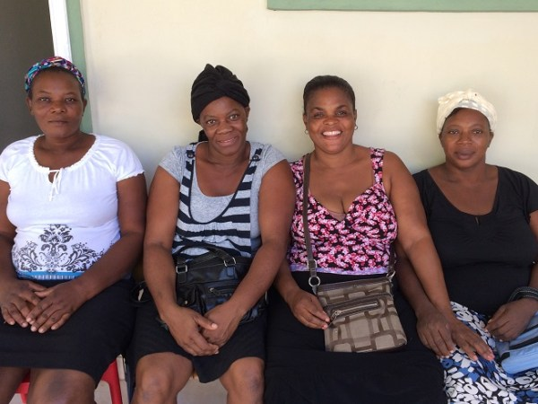 Nanotte on the left waiting to be seen with other Haitian women at Klinik Manitane.