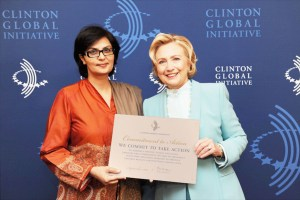 Sania Nishtar smiles with Hillary Clinton following the Heartfile Commitment to Action. Credit: Barbara Kinney / Clinton Global Initiative