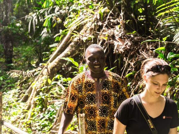 Bartue of Last Mile Health and Jenny of Direct Relief hike through forests from Piah to Gbarwu, Liberia
