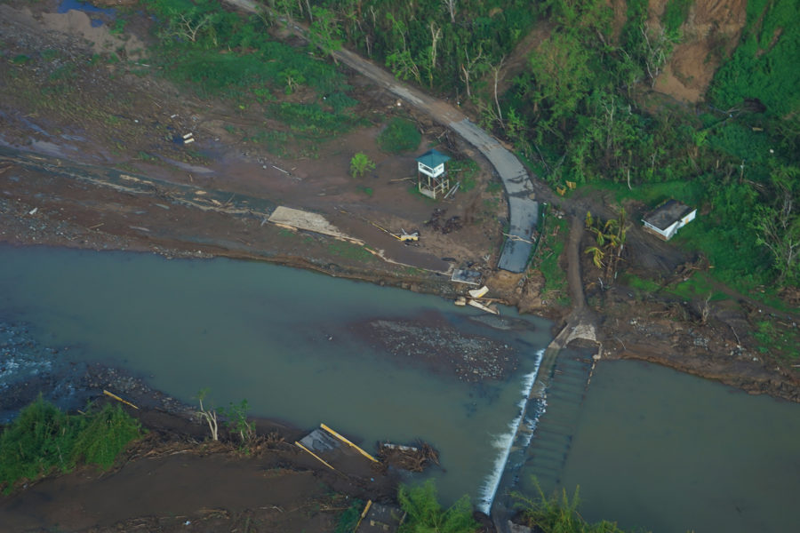 A bridge connecting Utuado to outside roads is seen in the bottom right corner of the frame, washed away by recent rains. (Lara Cooper/Direct Relief)