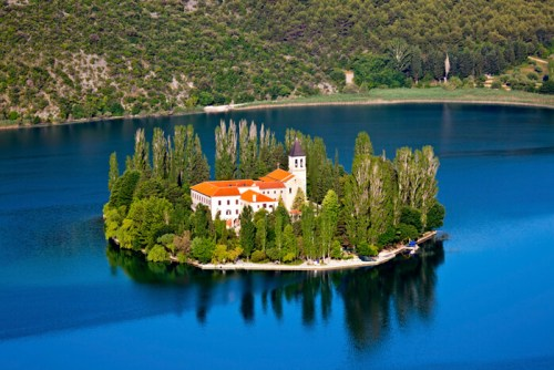 A small island with a Christian monastery on river Krka, Croatia - Europe.
