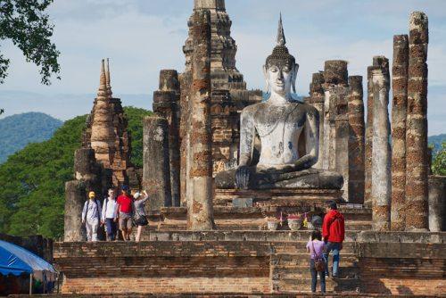 SUKHOTHAI, THAILAND - NOVEMBER 11, 2013: Unidentified people visit Buddha statue at Wat Mahathat in Sukhothai, Historical park Sukhothai Thailand.