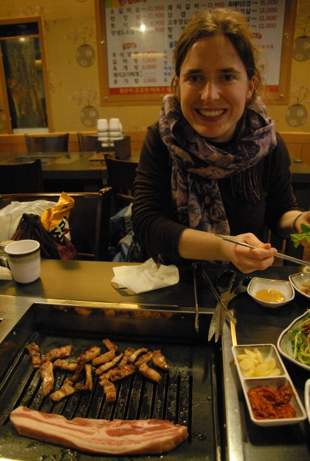 My wonderful wife preparing to eat some black pork. And you can see some of the side dishes. ^^