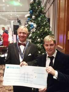 Paul Brown receiving cheque from Michael Jennings
