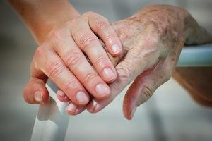 child holding grandparent hands