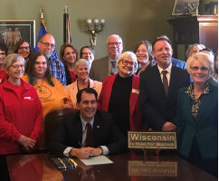 Advocates and legislators at bill signing with Governor Walker for support decision making