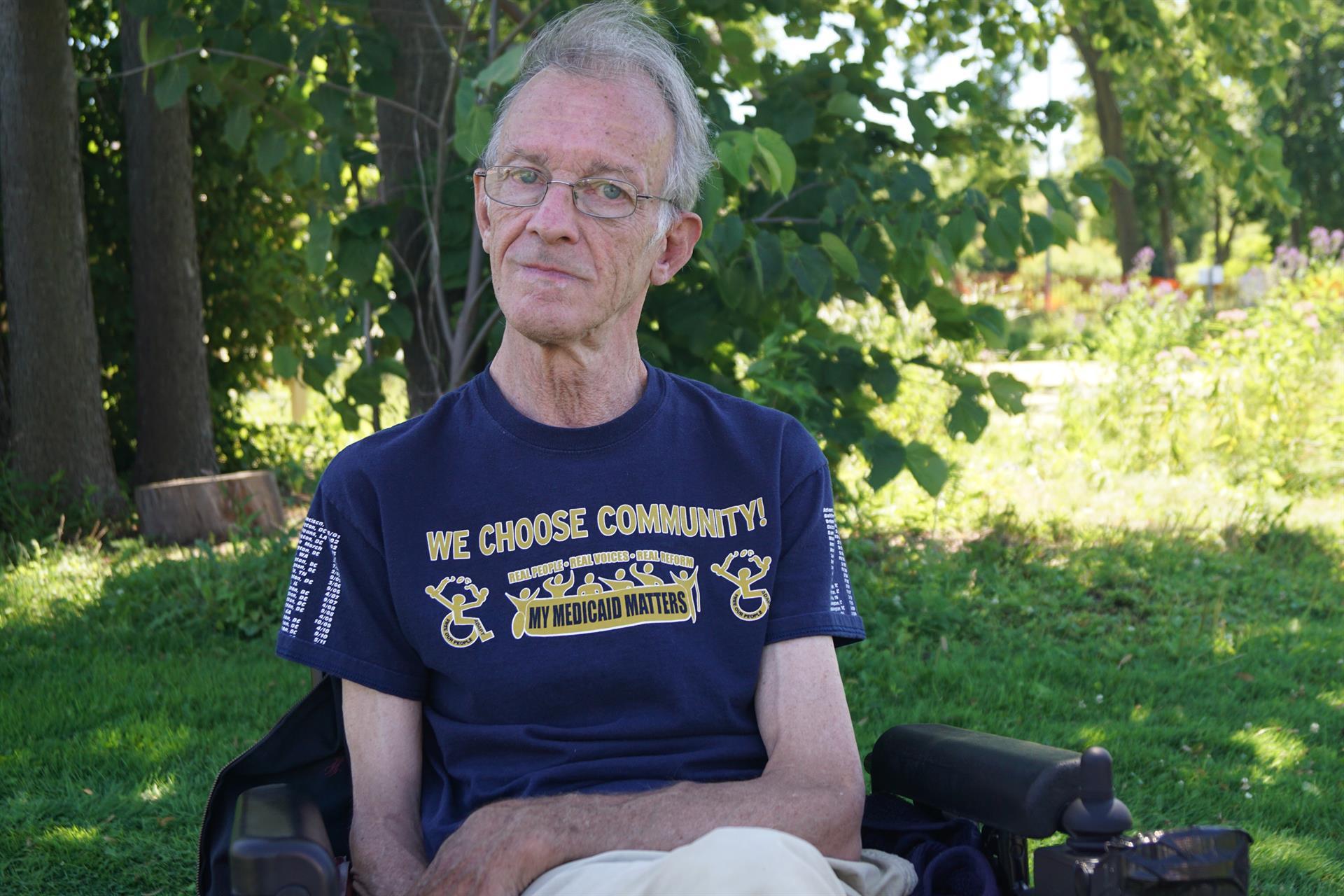 Elderly disabled man wearing a