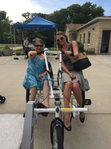 DRW Attorney Shirin Cabraal and intern Dena Welden on an adaptive bicycle