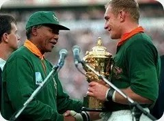 nelson-mandela-hands-over-william-webb-ellis-cup-springbok-captain-francois-pienaar-after-south