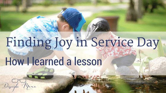 Two toddler boys playing by a creek with text overlay: Finding Joy in Service Day - How I Learned a Lesson