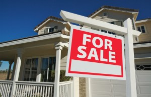 buy home for sales sign in front of new house