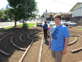 Bobby Harkleroad pauses from working on his Eagle Scout project on Washington Street 2017-06-10