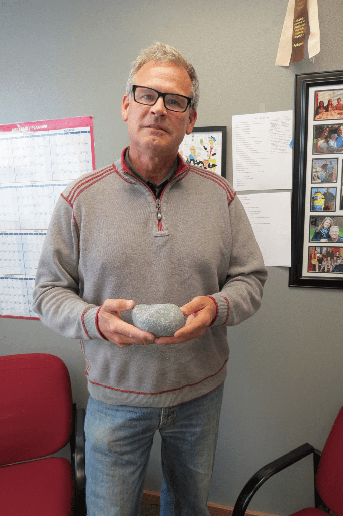 mayor jon mutchler shares one of the well worn rocks brought up during the drilling of the 2nd pw shop well 2018-05-03