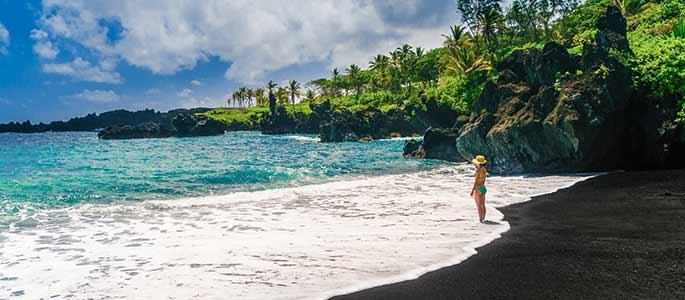 Visit Waianapanapa black-sand beach