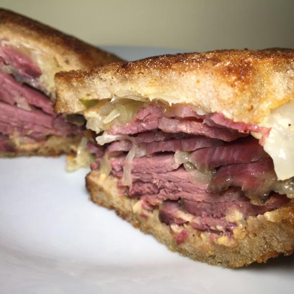 Reuben sandwich with corned beef, sauerkarut and Russian dressing deli