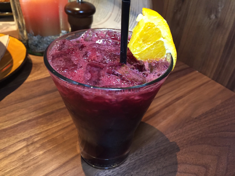 Trade Winds made with Hangar 1 Mandarin Blossom Vodka, St Germain, blueberry, fresh lemon juice - Jimmys Famous