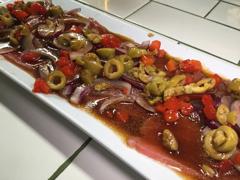 Large pieces of fresh tuna with olives and red peppers - Tijuana
