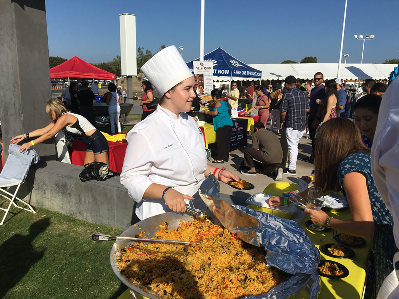 Serving samples of their veggie paella