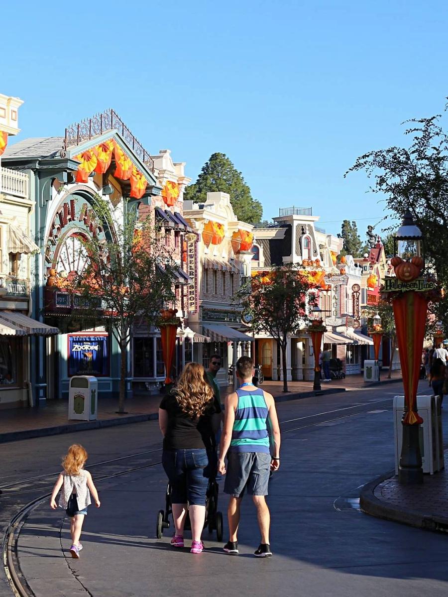 Strollers in Disneyland, walking down Main Street Disneyland