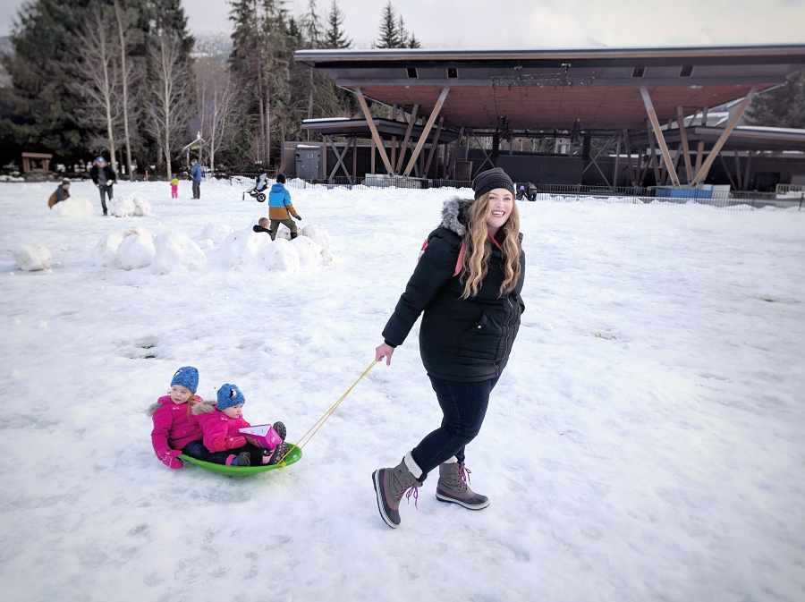 Pulling a sled in Whistler Olympic Plaza