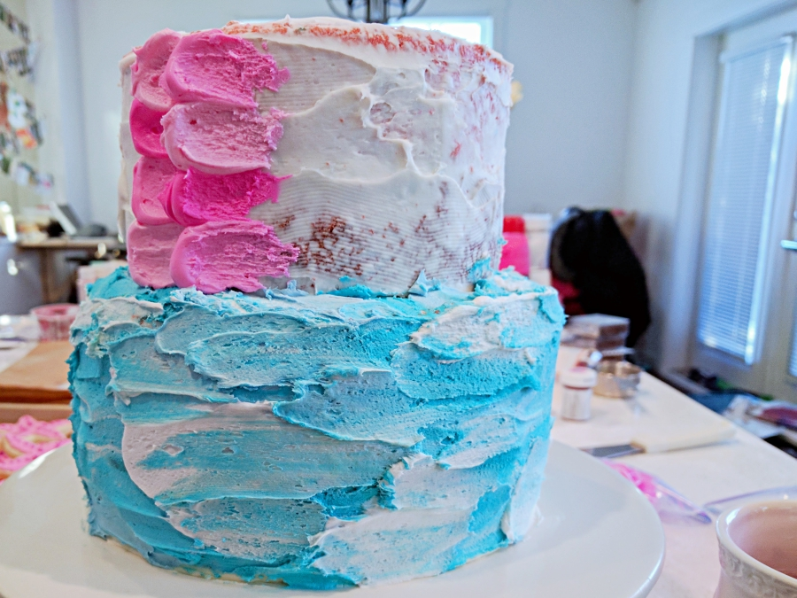 cake layers decorated to look like the ocean and a mermaid's tail