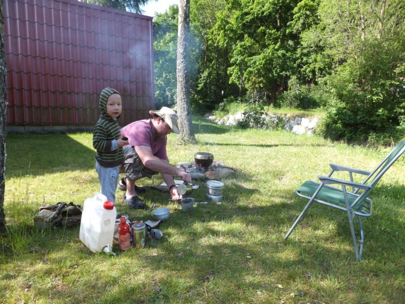 Dinner cooking on the fire, coffee brewed with my venerable Trangia. Our Kid paying no attention whatsoever to this valuable lesson in camp craft.Czech camping.