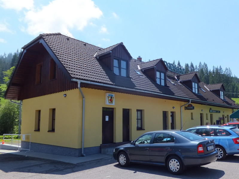 The Mountain Rescue Centre (left half of the building), conveniently located next to the pub (right half of the building). Czech camping.