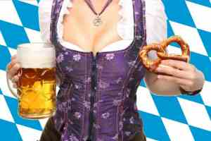 Girl in Bavarian dress holding a beer and pretzel
