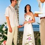 A beach wedding at Stonehaven Bay. Photographer: Courtesy Plantation Beach Villas
